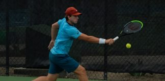 Brandon Holt returns the ball in matchplay during the 2020 Oracle ITA Masters by UTR