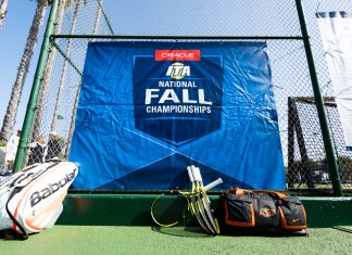 Tennis equipment rests along an event banner at the 2019 Oracle ITA National Fall Championships