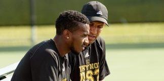Alan Green of XULA Men's Tennis talks with a player pre-covid