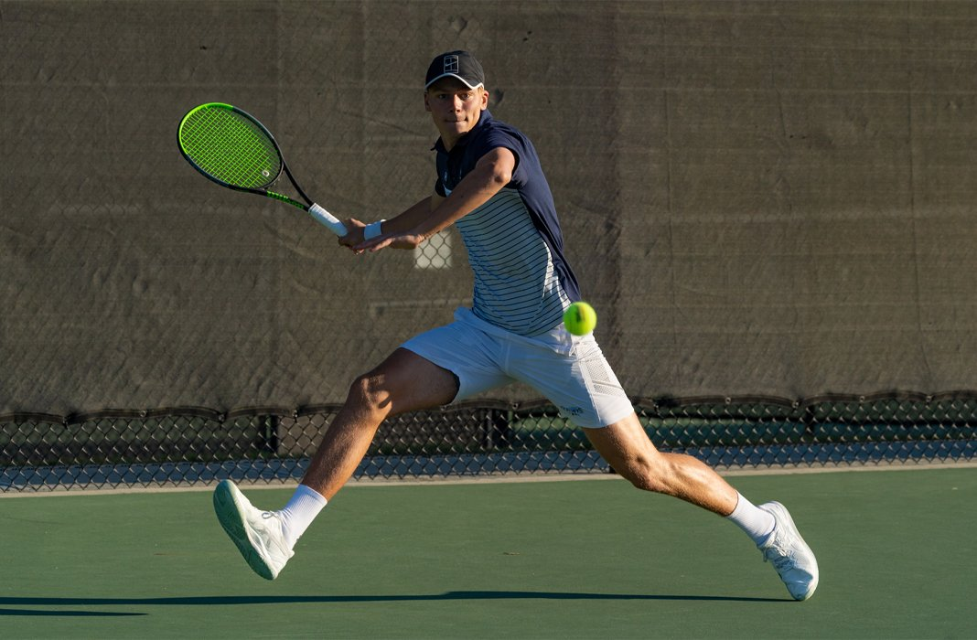 Luke Simkiss of Keiser University men's tennis focuses on returning during the 2020 ITA Cup in Rome, Georgia